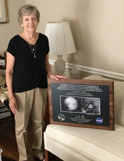 Joan Coughlin presented with plaque in honor Tom Coughlin